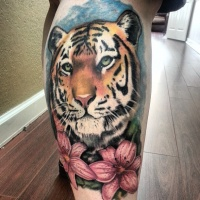 Tattoo tiger on the calf muscle